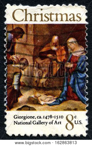 UNITED STATES OF AMERICA - CIRCA 1971: A used postage stamp from the USA depicting a festive nativity painting by Giorgione circa 1971.