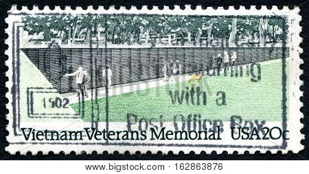 UNITED STATES OF AMERICA - CIRCA 1984: A postage stamp from the USA depicting an illustration of the Vietnam Veterans Memorial in Washington DC circa 1984.