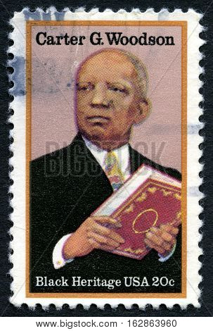 UNITED STATES OF AMERICA - CIRCA 1980: A used postage stamp from the USA depicting a portrait of African-American historian author and journalist Carter G. Woodson circa 1980.