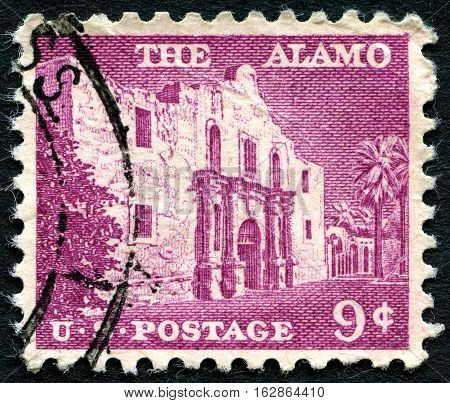 UNITED STATES OF AMERICA - CIRCA 1956: A used postage stamp from the USA depicting an illustration of the chapel of the Alamo Mission in San Antonio Texas circa 1954.