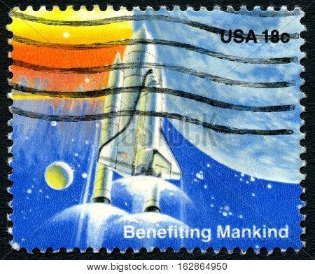 UNITED STATES OF AMERICA - CIRCA 1981: A used postage stamp from the USA celebrating achievements in Space with the phrase Benefiting Mankind and an illustration of a Space Shuttle circa 1981.