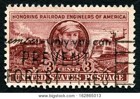 UNITED STATES OF AMERICA - CIRCA 1945: A used postage stamp from the USA issued to honor the skilled work of the Railroad Engineers of America circa 1945.
