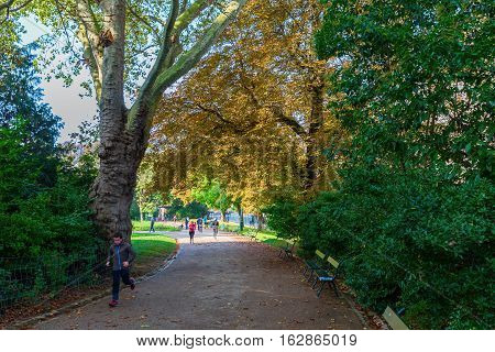 People Are Jogging In The Park Buttes-chaumont In Paris, France