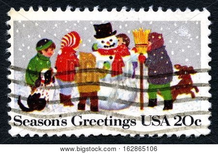 UNITED STATES OF AMERICA - CIRCA 1982: A used postage stamp from the USA celebrating the Christmas season with an illustration of children making a snowman circa 1982.