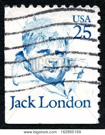 UNITED STATES OF AMERICA - CIRCA 1986: A used postage stamp from the USA depicting a portrait of famous author Jack London circa 1986.