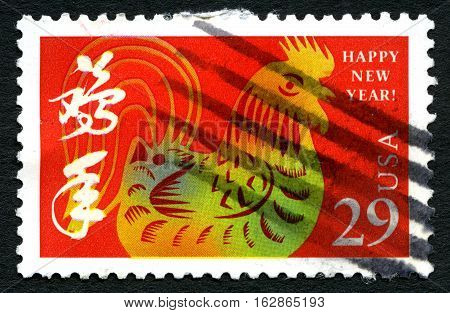 UNITED STATES OF AMERICA - CIRCA 1998 - A used postage stamp from the USA celebrating and wishing everyone a Happy Chinese New Year circa 1998.