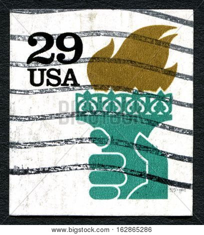 UNITED STATES OF AMERICA - CIRCA 1990: A used postage stamp from the USA depicting an illustration of the flame held by the Statue of Liberty circa 1990.