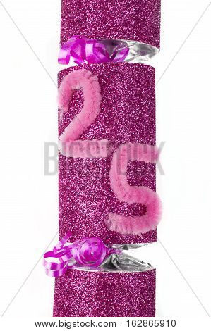 A shot of a 25th Birthday or Anniversary Cracker also known as a Bon Bon. A traditional cracker consists of a cardboard tube wrapped in a brightly decorated twist of paper with a gift in the central chamber.