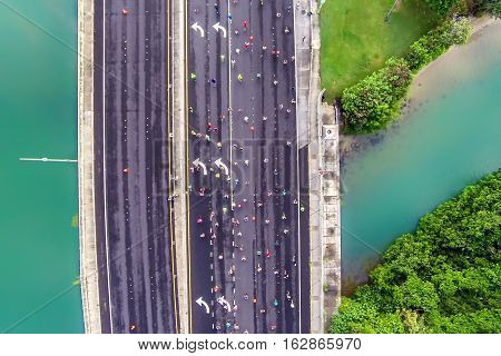 Aerial bird's eye view of Hawaii Kai as Honolulu Marathon participants traverse over a bridge