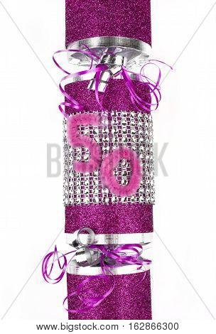 A shot of a 50th Birthday or Anniversary Cracker also known as a Bon Bon. A cracker consists of a cardboard tube wrapped in a brightly decorated twist of paper with a gift in the central chamber.