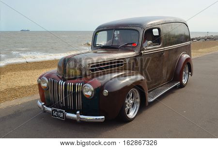 FELIXSTOWE, SUFFOLK, ENGLAND - AUGUST 27, 2016: Classic Ford Van  on seafront promenade.