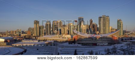 CALGARY, CANADA - DEC 17: Sweeping skyline view in the morning on December 17, 2016 in Calgary, Alberta. Calgary is home to many oil companies. Scotiabank Saddledome is in the foreground.