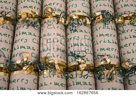 A studio shot of Christmas Crackers or otherwise known as Bon Bons. A traditional cracker consists of a cardboard tube wrapped in a brightly decorated twist of paper with a gift in the central chamber.