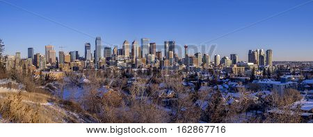 CALGARY, CANADA - DEC 17: Sweeping skyline view in the morning on December 17, 2016 in Calgary, Alberta. Calgary is home to many oil companies.