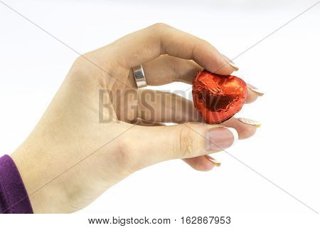 Woman's Hand Holding Sweet Red Heart
