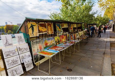 Bouquinistes At The Banks Of The Seine In Paris, France