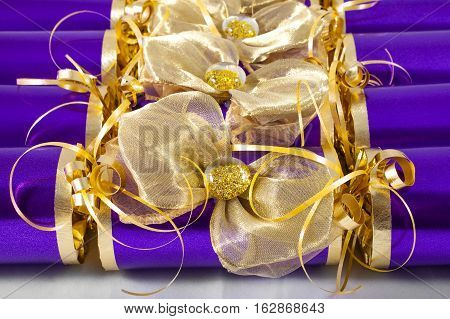 A studio shot of Crackers or otherwise known as Bon Bons. A traditional cracker consists of a cardboard tube wrapped in a brightly decorated twist of paper with a gift in the central chamber.