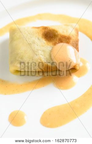 Hungarian Hortobagyi Palacsinta or Crepe a la Hortobagy a savory thin pancake filled with minced meat and served with a paprika and sour cream sauce based on the sauce of the meat photographed with natural light (Selective Focus Focus on the front of the
