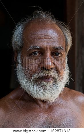 KERALA, INDIA. 23 January 2011:  Rural residents in daily life. Eyes in which the world... Closeup portrait of an old peasant.  Chowara, Kerala, South-west India.