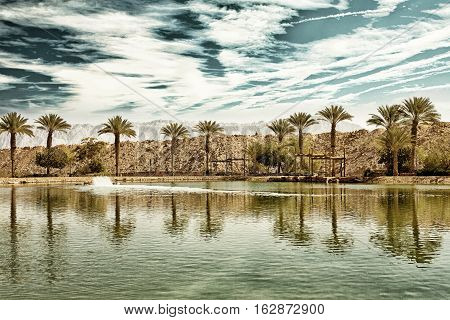 The Timna oasis Lake in Timna National park near to Eilat Israel (HDR image with black gold filter)