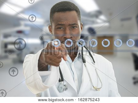 Angry african black male doctor pointing finger at you with stethoscope around his neck, pointing at camera with serious face isolated on white background