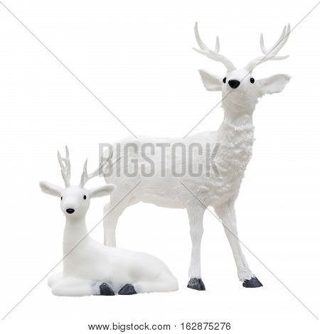 Christmas figurine of a deer and fawn. Isolated white background.