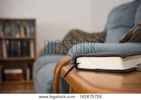Indoor Waiting Area with book for reading on table.