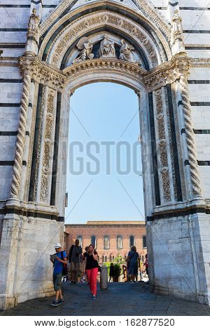Archway To The Piazza Del Duomo In Siena, Italy