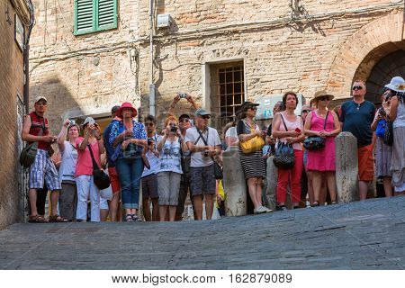 Tourists Looking To The Piazza Del Campo, Siena, Italy