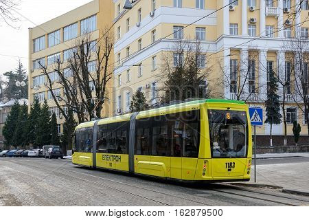 Ukraine Lviv - December 17 2016: Modern tram on city street. Modern environmentally friendly urban electric production corporation
