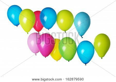 Colorful balloons with patches of light on light background