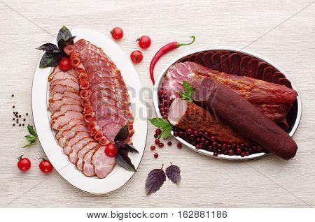 Deli meat on plate. Deli meat on plate. light wood, restaurant serving.