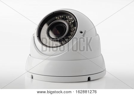 dome secure camera on light background, surveillance camera
