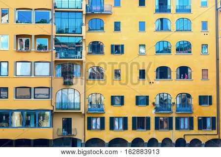 Facades Of Old Buildings Along The River Arno In Florence, Italy