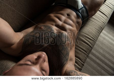 Handsome Shirtless Tattoo Young Man Laying In Bed