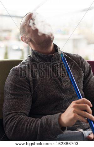 Man Smoking Shisha Outdoor