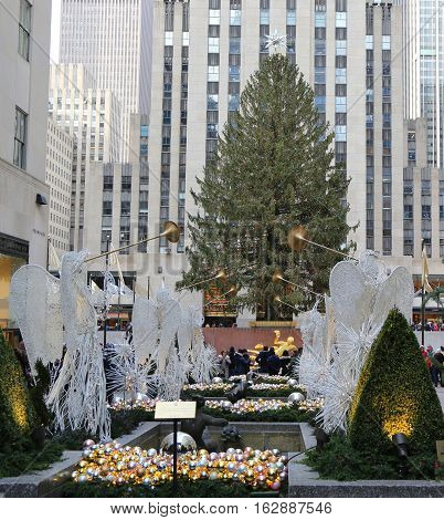 NEW YORK CITY- DECEMBER 15, 2016: Angel Christmas Decorations and Christmas Tree at the Rockefeller Center in Midtown Manhattan
