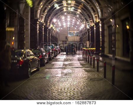 Check in the hotel Ritz Carlton Moscow on the background of expensive cars at the arched entrance in night poster