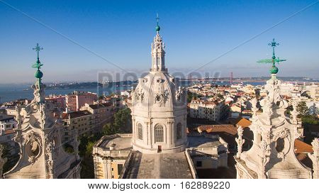 Dome of the Estrela Basilica on a background of Lisbon at morning