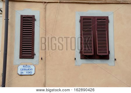Vinci Italy - September 7 2016: Window shutters on Piazza Leonardo Da Vinci in Vinci city in Tuscany Italy.