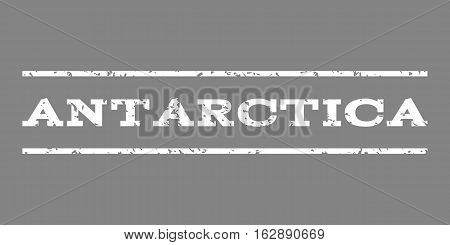 Antarctica watermark stamp. Text tag between horizontal parallel lines with grunge design style. Rubber seal stamp with scratched texture. Vector white color ink imprint on a gray background.