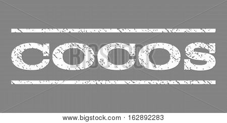 Cocos watermark stamp. Text tag between horizontal parallel lines with grunge design style. Rubber seal stamp with dirty texture. Vector white color ink imprint on a gray background.