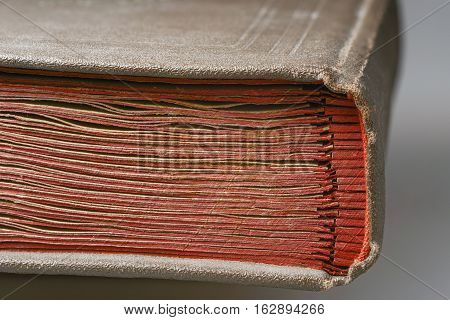 bookbinder fragment of vintage album with red carton pages