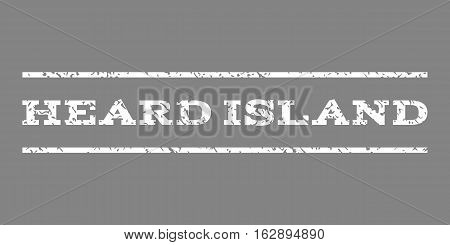 Heard Island watermark stamp. Text caption between horizontal parallel lines with grunge design style. Rubber seal stamp with scratched texture. Vector white color ink imprint on a gray background.