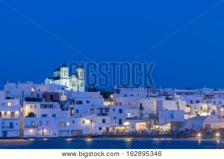 Beautiful blue hour of local church of Naoussa village at Paros island.