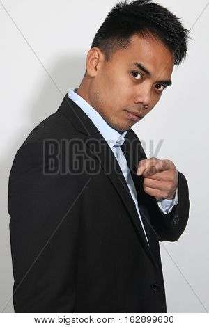 Young Businessman Filipino over a white background