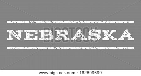 Nebraska watermark stamp. Text caption between horizontal parallel lines with grunge design style. Rubber seal stamp with unclean texture. Vector white color ink imprint on a gray background.