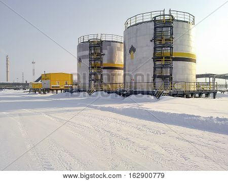 Russia Nefteyugansk - January 24 2016: A view of oil field equipment. Tanks with oil owned oil company Rosneft.