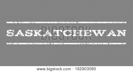Saskatchewan watermark stamp. Text caption between horizontal parallel lines with grunge design style. Rubber seal stamp with scratched texture. Vector white color ink imprint on a gray background.