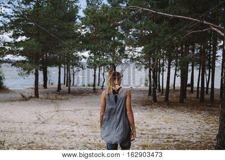 Female traveler admiring a marine view. Instagram filter look.